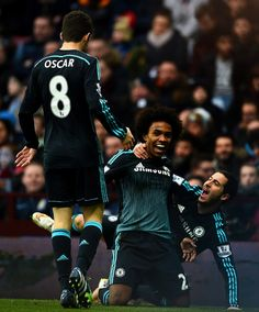 Eden Hazard Photos - Eden Hazard of Chelsea celebrates with team-mates Willian and Oscar after scoring the opening goal during the Barclays Premier League match between Aston Villa and Chelsea at Villa Park on February 7, 2015 in Birmingham, England. - Aston Villa v Chelsea - Premier League
