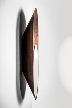 Miroir Mono mirror design  This design could work as a means of hanging bowls and other beautiful ceramics that need to be seen in plan
