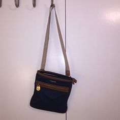 Michael Kors Navy crossbody bag Navy bag with adjustable tan strap and leather accents with gold hardware. Michael Kors Bags Crossbody Bags