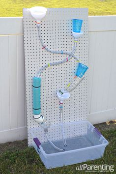 water wall: step-by-step instructions and photos to make a fun water wall for backyard play for kids! (Step Back Kids) Backyard Playground, Backyard For Kids, Outdoor Play Spaces, Outdoor Fun, Summer Activities For Toddlers, Water Activities, Water Play For Kids, Water Walls, Water Toys