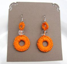 Crocheted earring, orange color with clear bead