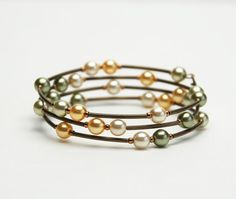 Green and Gold Memory Wire Bracelet - Green Sun Yellow Pale Gold Glass Pearls and Antique Brass Curved Tube Beads
