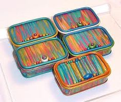Cover altoid boxes in polymer clay and paint!