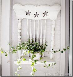 @Kathy Brady --this would be cute on your porch :)  Clever, repurpose an old chair into a shelf. Love this idea!