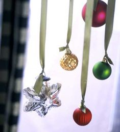 Use your tiniest ornaments to decorate windows. Tie ribbon to each ornament and hang at staggered heights from the curtain rod.
