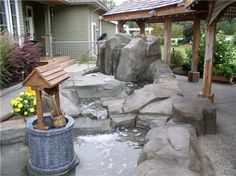 Custom outdoor waterfall features ranch style design elements.  Elements of Concrete Maple Ridge, BC