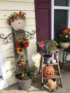 I like the idea of using a shutter as a focal point; adding a fall bouquet, angel wings, halo of leaves. Cuteness overload!