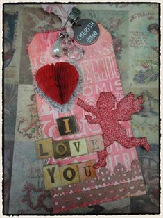 I don't necessarily like this tag, but the link will take you to a TON of great tutes from Tim Holtz. Great techniques! Well worth the time to explore!