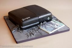 Xbox One cake, complete with box copy of Call of Duty: Ghosts.