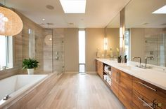 Enchanting Ceramic Tile Design Ideas For Elegant Bathroom As Well Beautiful Pendant Lamps Above Bathtub Including Wooden Vanity Double Sink Plus Drawer Storage Contemporary Ceramic Tile Design Ideas For Bathrooms Wall: Make Your Design Simple Look Bathroom