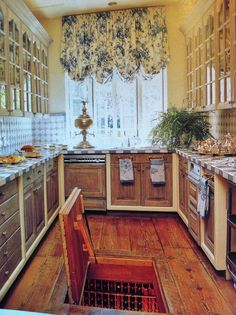 French Country kitchen with a wine cellar in the floor- I don't even drink wine but this is really cool