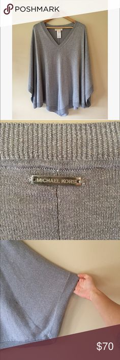 """Michael Kors Silver Poncho Sweater Metallic stitching adds some sparkle to this very cozy and versatile poncho. Never worn, one size. 34"""" long. Michael Kors Sweaters"""