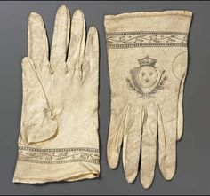 Pair of women's gloves, France, late 18th century. White kid printed in black: with a design of French arms, border with scrolling flowering vine.