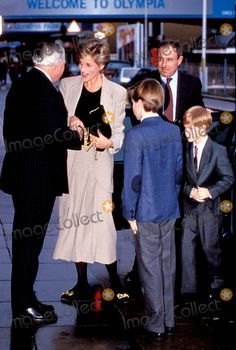Princess Diana with Price William and Prince Henry Horse of the Year Show Olympia, London Photo:dave Chancellor/alpha/Globe Photos Inc 1993 Princessdianaretro 12/18/
