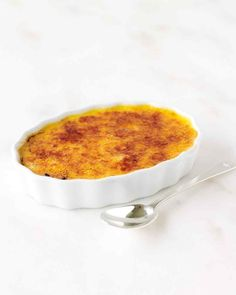 """The allure of creme brulee, French for """"burnt cream,"""" is in the textural contrast between the brittle caramelized topping and the smooth, creamy custard beneath."""