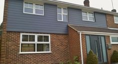 grey house cladding and front doors | External wall cladding projects gallery & design ideas