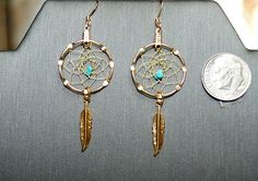 Turquoise chips are woven near the center and a feather hangs from the bottom. Your choice of ear wires, posts, or lever backs Turquoise Earrings, Gold Earrings, Dream Catcher Jewelry, Ear Cuffs, Feathers, Chips, Beads, Handmade, Etsy