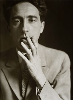 Jean Cocteau, 1929, photographed by Germaine Krull . Reminds me of Miss Moss in the Obsession ad