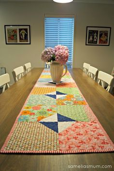 Layers of Charm table runner by Samelia's Mum. Link to free pattern by the Fat Quarter Shop