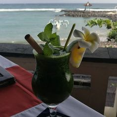 Green juice with sea view.