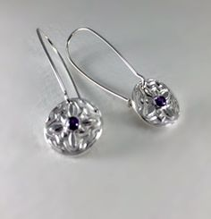 Fine silver disc that measures 5/23 inches and hangs approximately 1 1/2 inches down from the ear. These earrings are on kidney wires that close in the back. The 3 mm stone is amethyst.