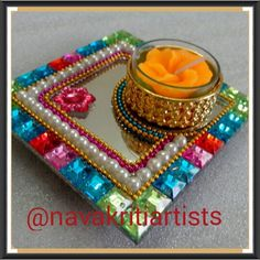 """Size 4"""" Tealite Holder on a mirror base with colorful stones. Add that colorful zing to your house, pooja Thalis, wedding favors, wedding decoration or festive decoration. #weddingfavors #wedding #desibrides #decoration #bride #beautiful #candle #candlelove #favors #groom #gifting #handmade #indianwedding #indianbridal #instapic #instagood #new #picoftheday #Rangoli #reception #shagun #stunning #tealite"""