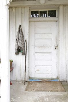 A simple but elegant door on a farm in West Telemark, Norway