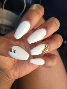 White acrylic coffin nails with gold jewels