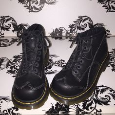 Brand New Black Doc Marten's with wing tips Black Doc Marten's with wing tips. They don't have tags or box , but they've never been worn. These are super cute with wing tips in the front and flower like details on the sides. It also has the Doc Marten symbol imprinted towards the back heels. Smoke free home. Dr. Martens Shoes Ankle Boots & Booties