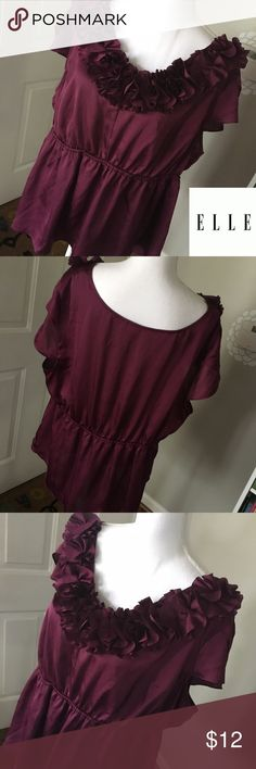 """Elle Size 2X Rosette Embellished Plum Top NWOT This beautiful top is from Elle and is a size 2x. It's NWOT as it's been hanging in my closet and I'm finally doing some spring cleaning to clear our. Fabric is 100% poly and the color is a very deep eggplant or plum. Has rosettes along the neckline for a flirty look and an elastic accent at the waistline for added shape. Length is 26.5"""" and pit to pit flat across the back is 25"""", waist is 20"""" across flat unstretched. Thank you for looking! ☺…"""