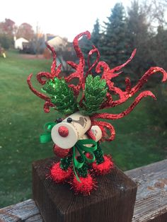 Made by Reindeer Love, this beautiful red and green wine cork reindeer is irresistible! Her face will melt your heart!  Made from repurposed wine