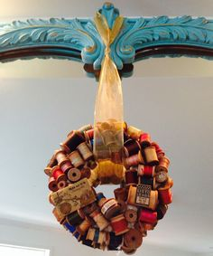 DIY wreath made from vintage thread spools.