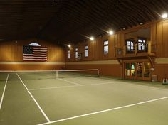 "The compound has a ""sports barn"" with a full-size indoor tennis court. The property also has a gym and a yoga studio."