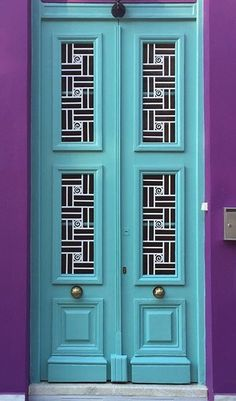 Pretty turquoise door with purple in Athens, Greece.