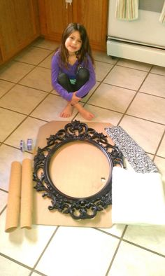 Making a Jewelry holder out of an Ikea frame, cork, batting, fabric, ribbons and safety pins. (Beginning)