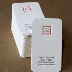 Embossed, simple, timeless with rounded corners + orange: business card.