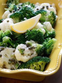 Broccoli and Cauliflower Salad with Capers and Lemon Vinaigrette - I can eat a whole bowl of this, but it's also great as a side. #lowcarb #paleo #weightwatchers #cleaneating #vegetarian #vegan #meatlessmondays