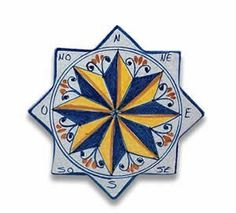 "Handmade Star-shaped Compass Tile From Italy by First Stones. $44.00. 8"" Diameter. Has hanger on the back of the piece so that you can hang it on any wall. Handmade and handpainted in Santo Stefano, Sicily. In the 16th century, Italians traditionally placed stones on the walls of new homes and gardens to assure blessings and prosperity. Today, we are pleased to carry on this tradition in the form of our ""First Stones? collection. Try hanging one of our Holy Water Fo..."