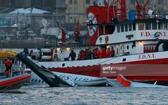 Rescue workers assist a New York City Fire Department boat pulling a US Airways plane floating in the water after crashing into the Hudson River in the afternoon on January 15, 2009 in New York City. The Airbus 320 flight 1549 crashed shortly after take-off from LaGuardia Airport heading to Charlotte, North Carolina.