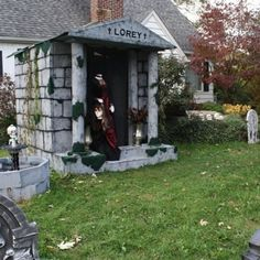 Halloween decor ideas: Marc Lorey says he likes using moving objects, such as the decapitated woman in front of the mausoleum, to scare visitors. (Photo courtesy of Dawn Lorey)