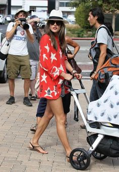 She's so cute! Adorable stroller cover too!