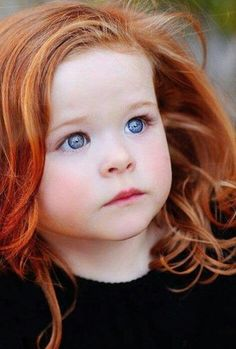 Red hair and beautiful blue eyes