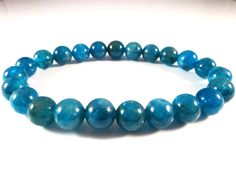 Apatite Stretch Bracelet Deep Teal Blue 8mm Smooth Round Polished High Quality Gemstone Beads Blue Green Peacock Electric by SandiLaneFineArt on Etsy