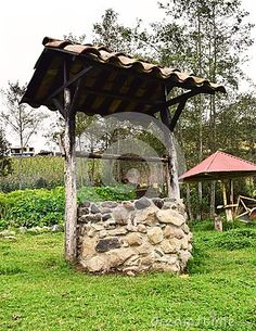 Photo about Old water well built in a garden, made of stone and wood. Image of waterhole, water, built - 114089456 Water Well, Gazebo, Wellness, Outdoor Structures, Stock Photos, Stone, Building, Wood, Garden