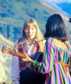 Joni Mitchell and Joan Baez, Big Sur, 1969. Not the warmest of relationships, as the established Joan Baez tried to prevent the emerging Joni Mitchell from appearing at the Newport Folk Festival in 1967. Judy Collins pushed for Joni's appearance and succeeded. They warily watched each other as part of the Bob Dylan Rolling Thunder Revue in 1975. Joan's passion for causes, anti-war, justice, equal rights never was matched by Joni but Joni's complex songwriting and music eclipesd Baez fair