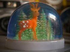 kitschy deer snow globe