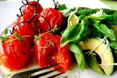 baked vine tomatoes with fresh thyme followed by baby spinach and avocado salad