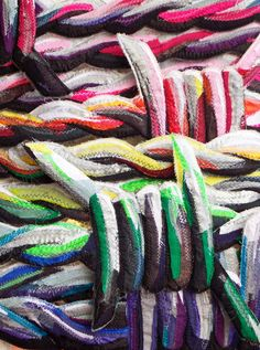 This is colourful barbed wire made from strips of fabric appliqued,machine embroidered, quilted and then cut out