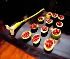 Passed hors d'oeuvres popped against black lacquer trays adorned with single Calla lilies.