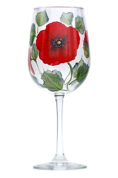 Red poppy flower petals with soft black shading and yellow and white centers and deep green leaves hand-painted on quality 18.5 ounce wine glass